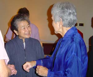 Haruko Adkins Enjoys a Discussion with State Senator Patsy Ticer