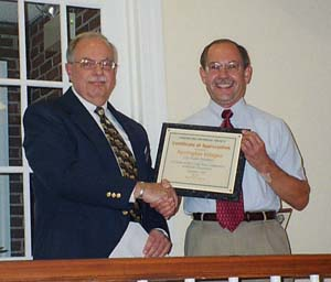Fairlington Villages President Guy Land Accepts a Certificate of Appreciation from FHS President Ron Patterson