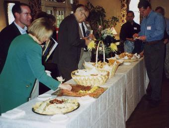 photo of attendees at food table, including Michael Hahn and Margo Horner (12874 bytes)