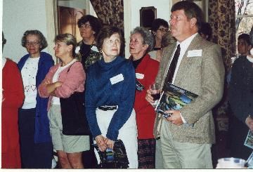 photo of attendees at celebration, including Joan McDermott, Catherine Fellows, and Tom Burke (15228 bytes)