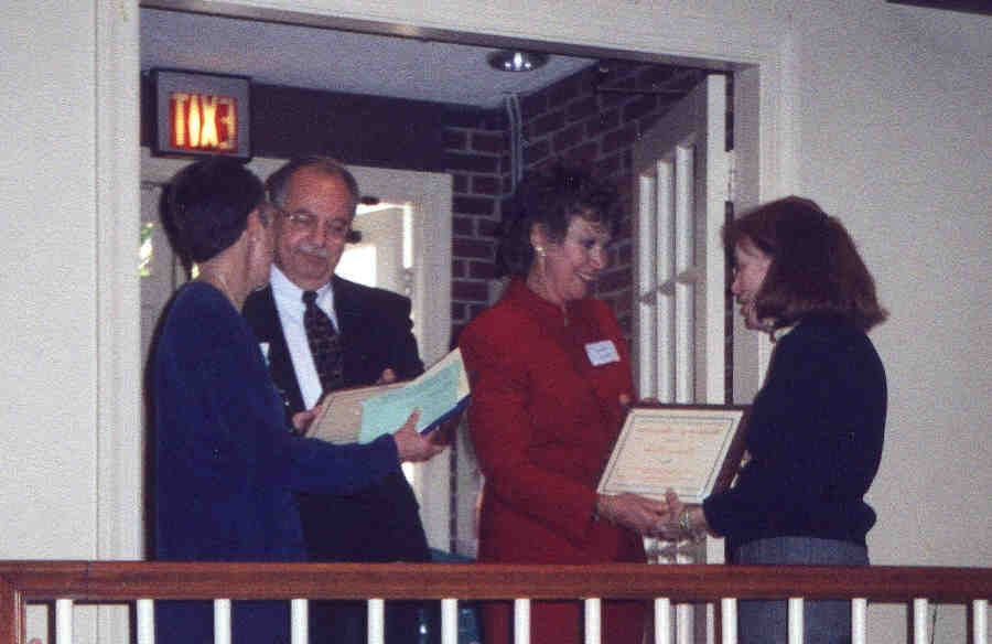 photo of Judith Greig and Lorraine Drolet receiving certificates from Terry Placek and Ron Patterson (12570 bytes)